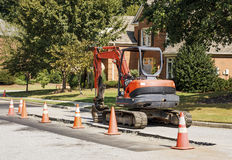 Orange Loader in Residential Construction Stock Photos