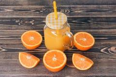 Orange, Lobule, Half, Juice. Healthy Lifestyle Concept. Orange, Half of Orange, Orange Lobule, Jar of Juice on the Wooden Table. Healthy Lifestyle Concept Stock Images