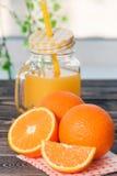 Orange, Lobule, Half, Juice. Healthy Lifestyle Concept. Orange, Half of Orange, Orange Lobule, Jar of Juice on the Wooden Table. Healthy Lifestyle Concept Royalty Free Stock Photo