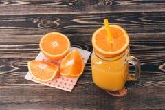 Orange, Lobule, Juice. Healthy Lifestyle Concept. Orange, Orange Lobule, Jar of Juice on the Wooden Table. Healthy Lifestyle Concept Stock Image