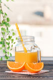 Orange, Lobule, Juice. Healthy Lifestyle Concept. Orange, Orange Lobule, Jar of Juice on the Wooden Table. Healthy Lifestyle Concept Stock Images