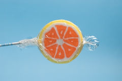 Orange lollipop Royalty Free Stock Image