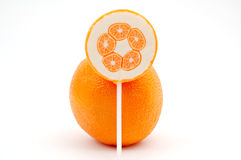 Orange with lollipop Stock Photos