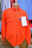 Orange Long Sleeve Work Shirt on Display in Weekend Market Royalty Free Stock Photo