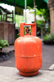 Orange LPG tank. Reusable orange tank of Liquefied Petroleum Gas or Liquid Petroleum Gas LPG used for domestic supply cooking, central heating, water heating Stock Images