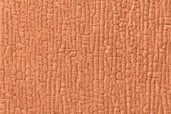 Orange luffy background of soft, fleecy cloth. Texture of textile closeup Royalty Free Stock Photos