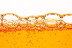 Orange Luftblasen Stockfoto