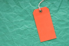 Orange Luggage Tag on Green stock images