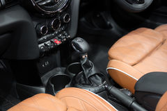 Orange luxury car Interior with steering wheel, shift lever and Royalty Free Stock Images