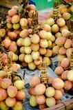 Orange lychee on asian market place stock image
