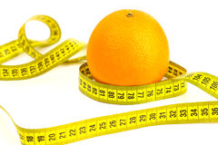 Orange mûre et ruban métrique Images libres de droits