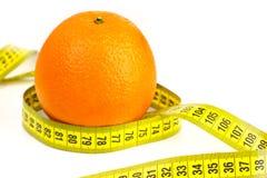 Orange mûre et ruban métrique Image stock