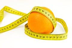 Orange mûre et ruban métrique Photographie stock libre de droits