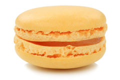 Orange macaron macaroon cookie dessert from France isolated. On a white background stock images