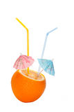 Orange is made an incision two umbrellas. Orange is made an incision with umbrellas and straws isolated on a white background Stock Photo