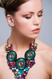 Orange makeup. Young woman with beautiful makeup and necklace Stock Photography