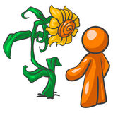 Orange man and big flower Royalty Free Stock Image