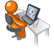 Orange man cartoon on computer. Orange man cartoon seated at desk and using computer Stock Photography