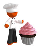 Orange Man Chef with Giant Cupcake Royalty Free Stock Photos