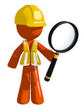 Orange Man Construction Worker  Holding Magnifying Glass Royalty Free Stock Images