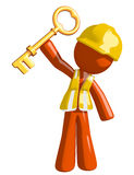 Orange Man Construction Worker  Holding Up Key to Success Stock Photo