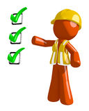 Orange Man Construction Worker  Pointing Green Checkmark List. On white Royalty Free Stock Photos