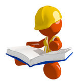 Orange Man Construction Worker  Sitting Reading Big Book Royalty Free Stock Image