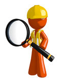 Orange Man Construction Worker  Standing with Magnifying Glass Stock Photography