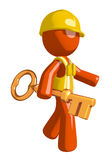 Orange Man Construction Worker  Walking with Gold Key Royalty Free Stock Image