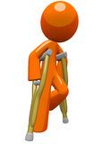 Orange Man  with Crutches Moving About Stock Image