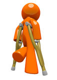 Orange Man with Crutches Rear View. An orange man with crutches, walking away, appearing sad or in pain. Rehabilitation and wellness image Stock Photo