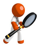 Orange Man Doctor Looking through Magnifying Glass Royalty Free Stock Image