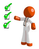 Orange Man Doctor Pointing Green Checkmark List. Isolated on white Royalty Free Stock Photo