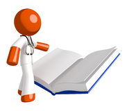 Orange Man Doctor Reading Open Book. Isolated on white Stock Images
