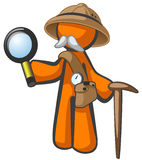 Orange Man Explorer with Magnifying Glass Royalty Free Stock Image