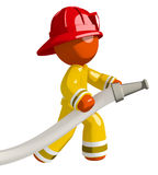 Orange Man Firefighter Using Firehose Royalty Free Stock Photos