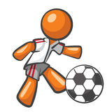 Orange Man Playing Soccer Royalty Free Stock Photo