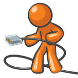Orange Man Plugged In. Orange Man plugging in a network cable ready to be on high speed internet or connection Stock Photos