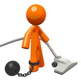 Orange Man Prisoner Vacuuming Ball and Chain. Man with a ball and chain, vacuuming. Definitely hard labor! Suggests the boring captive feeling of domestic chores Stock Images