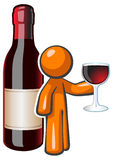Orange Man Red Wine Glass and Bottle. Orange person holding a glass of fine wine with a large wine bottle behind him. Created for advertising fine wine but with Royalty Free Stock Photo