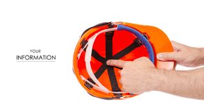 Orange man`s helmet in man`s hand pattern. On a white background isolation Royalty Free Stock Photos