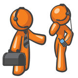 Orange Man Tech Support. Technical support. The woman is helping the guy actually Royalty Free Stock Image
