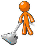 Orange Man Vacuuming. And cleaning house Royalty Free Stock Photo