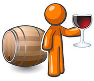 Orange Man Wine Cellar Keg and Glass of Wine. Orange man holding a glass of fine red wine, and a keg behind him, suggesting he may be in a wine cellar Royalty Free Stock Image