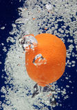 Orange (mandarin) falling in water Stock Photo