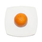 Orange mandarin on the plate. Royalty Free Stock Image