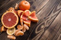Orange mandarin red on wood Royalty Free Stock Image