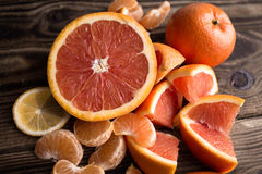 Orange mandarin red on wood Stock Photos