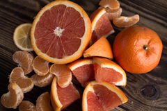 Orange mandarin red on wood Stock Photo