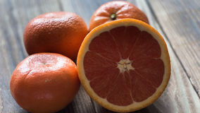Orange mandarin red on wood Stock Images